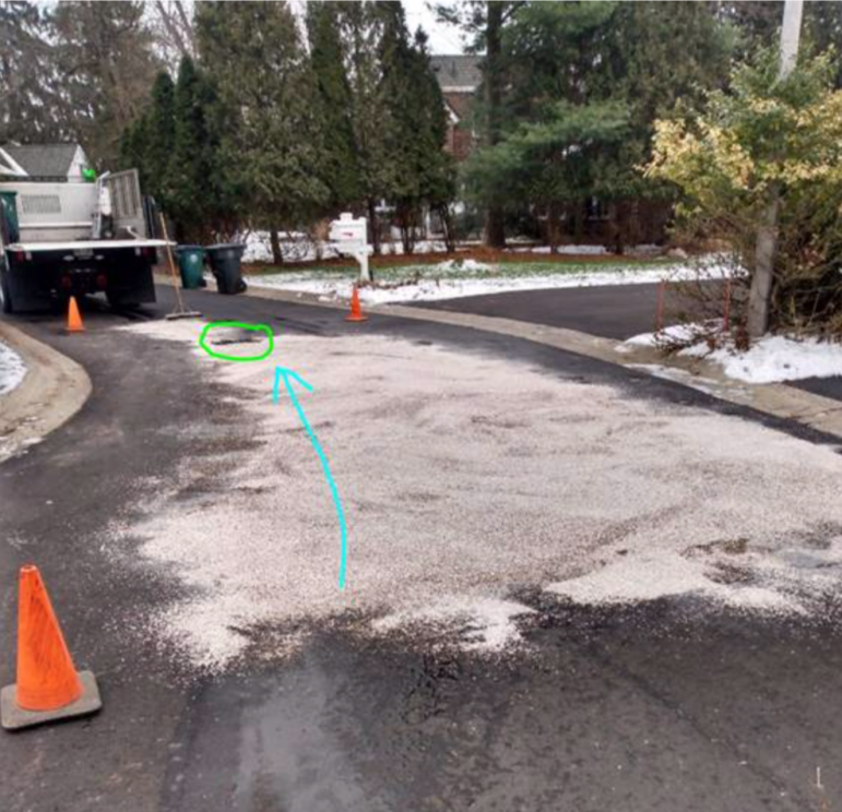 Shows annotated version of the photo of the oil spill at Abbott Woods in East Lansing.